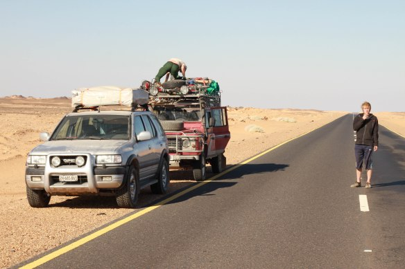 Exhaustion bites in the midday sun; Rob Lowe, British cyclist struggles on in the Nubian desert. (Photo: RWH)